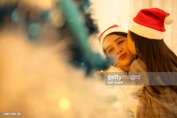 christmas joy in asian family - indonesia stock pictures, royalty-free photos & images