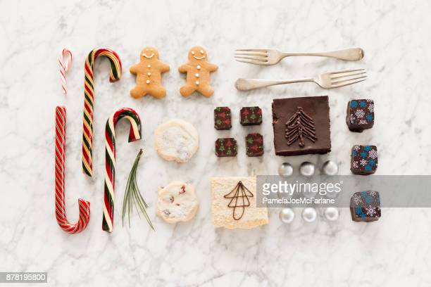christmas knolling, candy canes, chocolates, candy, shortbread, baking, gingerbread man - chocolate cake above stock pictures, royalty-free photos & images
