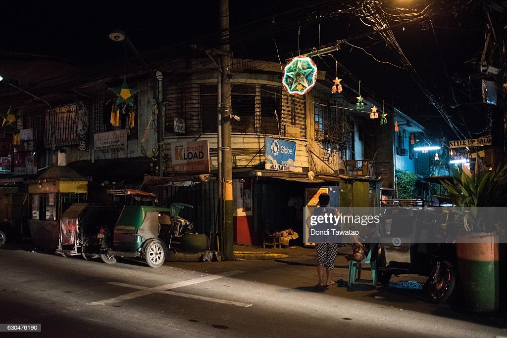 A christmas lantern hang outside an empty street near a crime scene which killed two alleged drug dealers on December 23, 2016 in Manila, Philippines. Philippine president Rodrigo Duterte has said he wanted the Constitution amended to allow Philippine leaders to wield martial law powers without judicial and congressional approval, a move he said is necessary to contain the ongoing 'drug menace' and maintain peace and security in the country. Around 5,882 people have been killed across the country since President Rodrigo Duterte launched his war on illegal drugs five months ago, according to figures from the Philippine National Police. An average of 25 victims were killed daily during the five-month period, and police kill 97 percent of those they shoot, leaving 33 dead for every person wounded according to the figures. Last October, Duterte himself said the country could expect about 20,000 or 30,000 more deaths in his administration's bloody war on drugs.