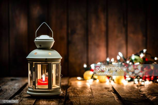 christmas lantern on wooden table. copy space - christmas decore candle stock pictures, royalty-free photos & images