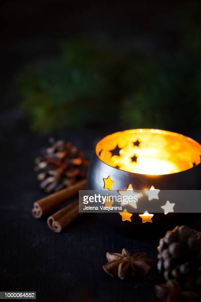 christmas lantern with a lit candle in the dark with festive decorations - candle in the dark stock pictures, royalty-free photos & images