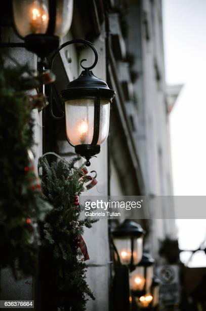 Christmas lanterns with decorative garland with light in the street of Montreal, Canada
