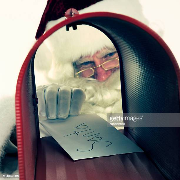 Christmas Letter Sent To Santa Claus in a Red Mailbox