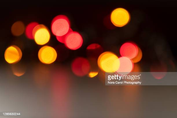 christmas light defocused - focus on foreground stock pictures, royalty-free photos & images
