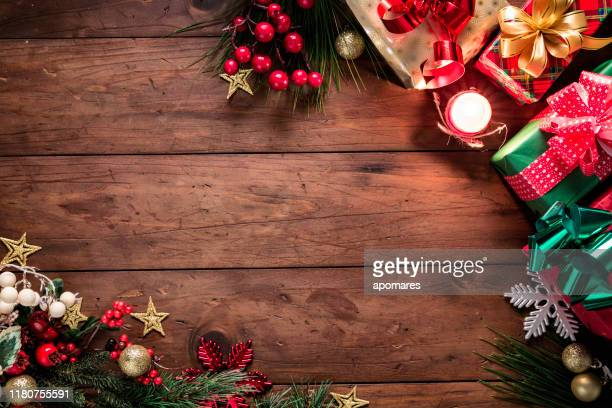 christmas lights and decoration with presents making a frame with copy space. christmas themes. - table stock pictures, royalty-free photos & images