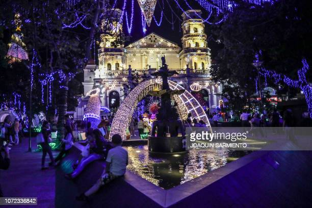 Christmas lights and decorations are seen at the Envigado Park near Medellin Antioquia department Colombia on December 12 2018