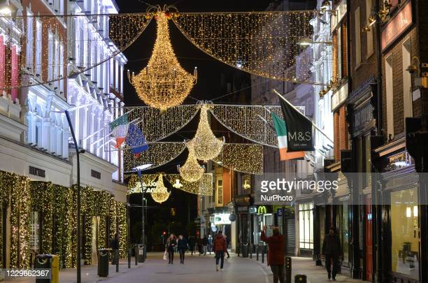 Christmas lights and decorations on Grafton Street, in Dublin's city center. The lights on Grafton Street, Henry Street, South William Street, Capel...
