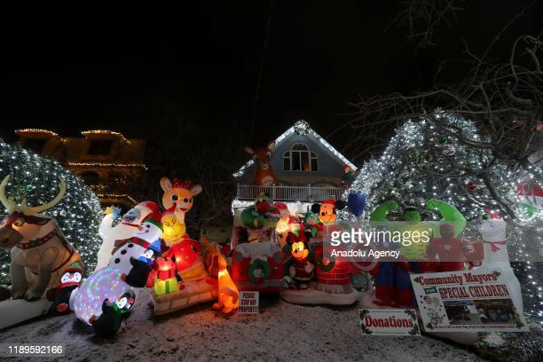 Christmas lights and ornaments are viewed outside of a home in Dyker Heights neighborhood of Brooklyn borough of New York, United States during...