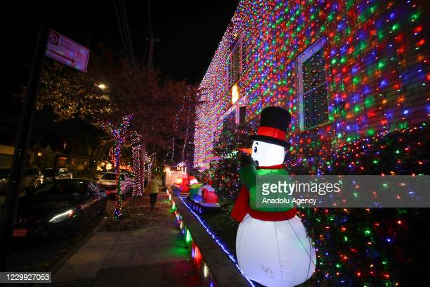 Christmas lights and ornaments are viewed outside of a home in Dyker Heights neighborhood of Brooklyn borough of New York, United States on December...