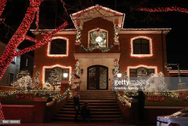 Christmas lights and other ornaments are viewed outside of a home in Dyker Heights neighborhood of Brooklyn borough of New York, United States on...