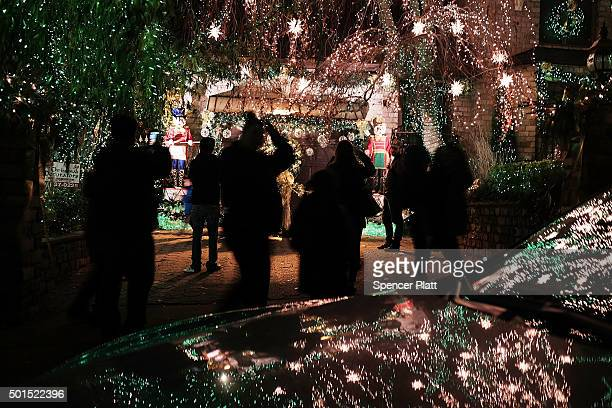 Christmas lights and other ornaments are viewed outside of a home on December 15, 2015 in the Dyker Heights neighborhood of the Brooklyn borough of...