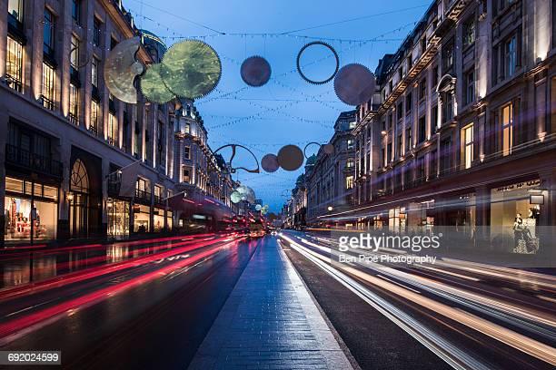 Christmas lights and traffic on Regent street at dusk, London, UK
