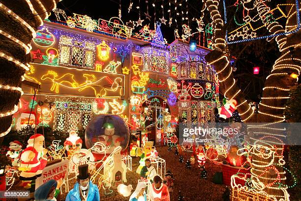 Christmas lights are displayed on a house on December 1 2008 in Melksham England The householder Alex Goodwind who says he does it to raise money for...