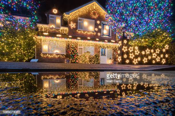 Christmas lights are displayed on houses in Trinity Close in Burnham-on-Sea on December 6, 2018 in Somerset, England. For over eleven years, the...