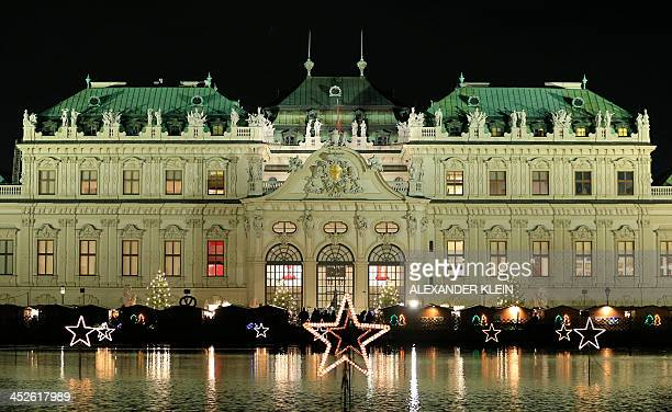 Christmas lights are seen in front of the Belvedere Palace in Vienna on November 30 2013 AFP PHOTO / ALEXANDER KLEIN
