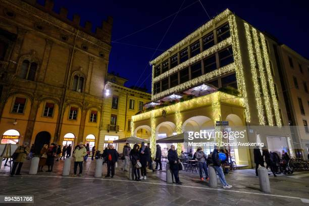 Christmas lights are seen on the wall of a palace in center of Bologna on December 17 2017 in Bologna Italy