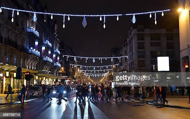Christmas lights at SaintCatherine and Grande Place square are illuminated in Brussels Belgium on November 30 2014