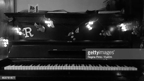 Christmas Lights Decorated On Piano At Home