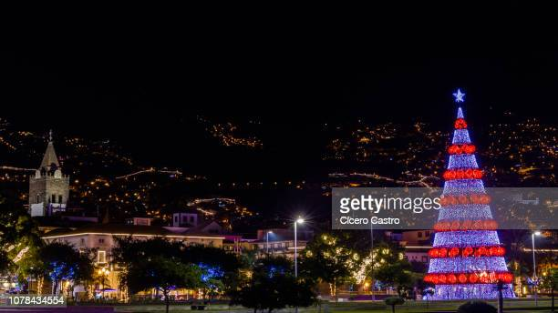 christmas lights decoration over funchal city. - funchal stock pictures, royalty-free photos & images