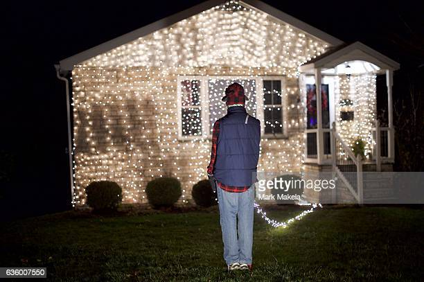 Christmas lights display and costumed mannequin recreates a scene from the film Christmas Vacation with Clark Griswold as portrayed by Chevy Chase in...