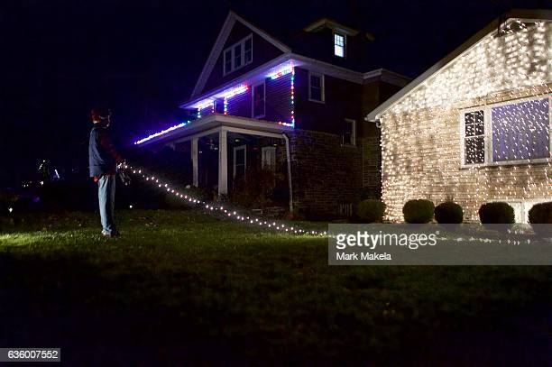 Christmas lights display and costumed mannequin recreates a scene from the film 'Christmas Vacation' with Clark Griswold as portrayed by Chevy Chase...