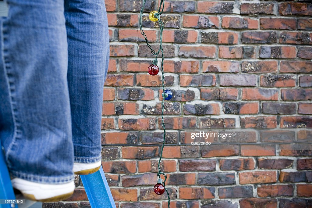 Christmas Lights Hanging From Ladder Outside Copy Space High