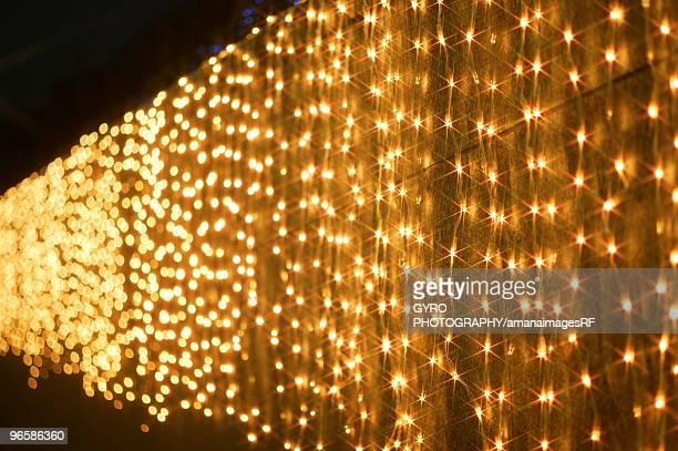 Christmas lights hanging over a wall