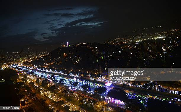 Christmas lights illuminate the Medellin River on December 9 2014 in Medellin Antioquia department Colombia AFP PHOTO/RAUL ARBOLEDA