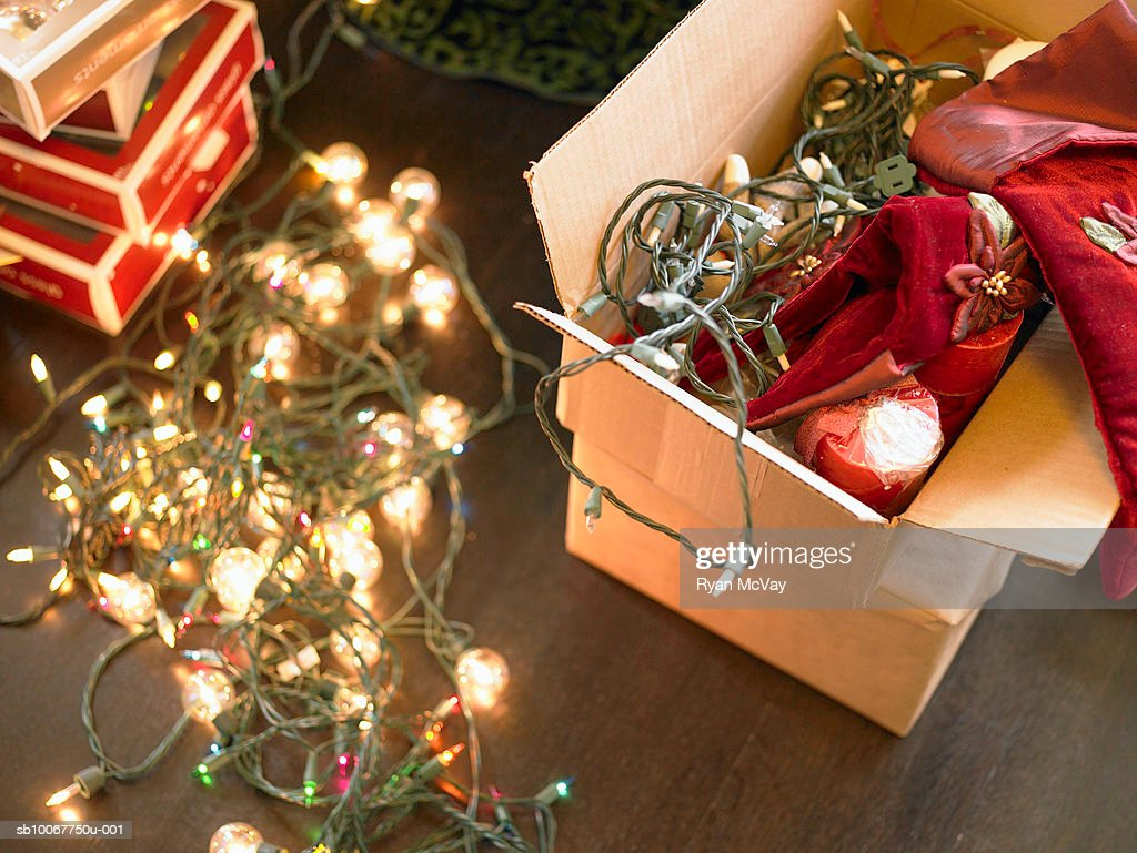 Christmas lights in boxes on floor : Stock-Foto