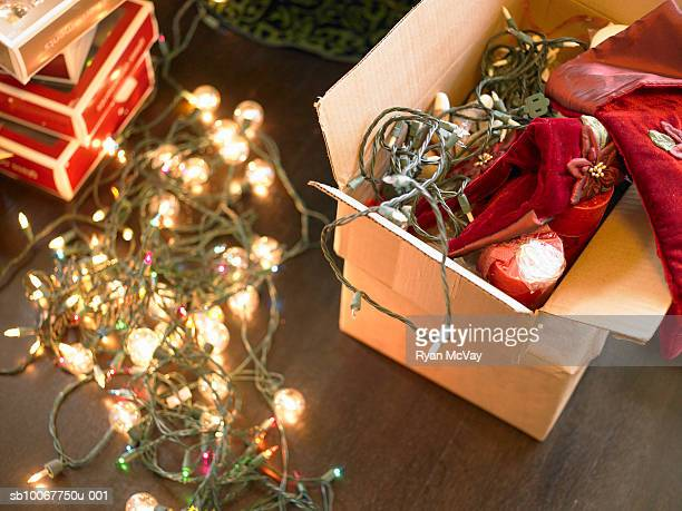 christmas lights in boxes on floor - christmas lights stock pictures, royalty-free photos & images