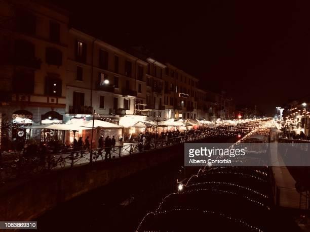 christmas lights in navigli district, milan, lombardy, italy - navigli milano foto e immagini stock