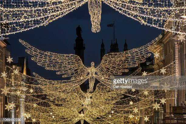Christmas lights in the shape angels hang in front of the Houses of Parliament on December 7, 2018 in London, England. Members of Parliament will...