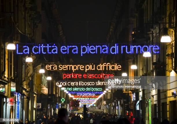 Christmas lights in Turin featuring a colorful poem along a shopping street, Italy
