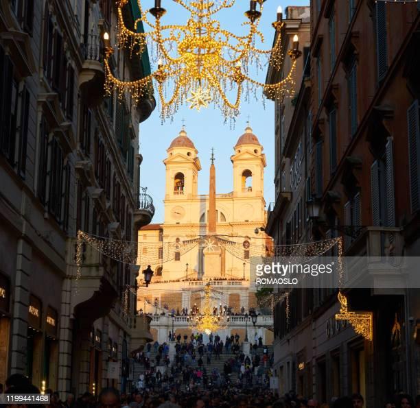 christmas lights in via condotti, rome italy - natale di roma foto e immagini stock