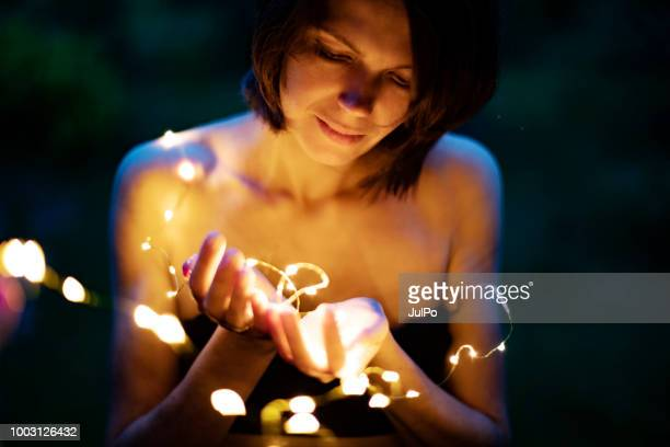 Christmas lights in woman hands