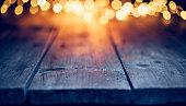 Christmas lights on empty table - Background Defocused Blue wood
