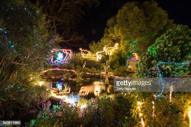 christmas lights on home in australia. - christmas background stock photos and pictures