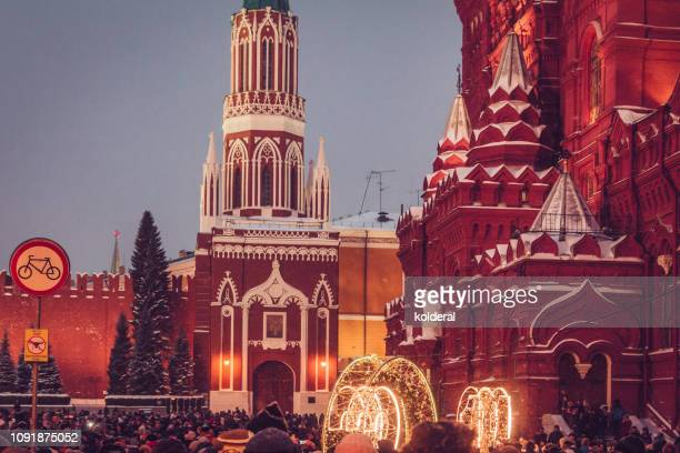 christmas lights on red square in moscow - orthodox christmas stock pictures, royalty-free photos & images