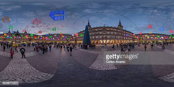 Christmas lights shine at Plaza Mayor square on December 17 2015 in Madrid Spain The traditional Christmas holiday period in Spain stretches from...