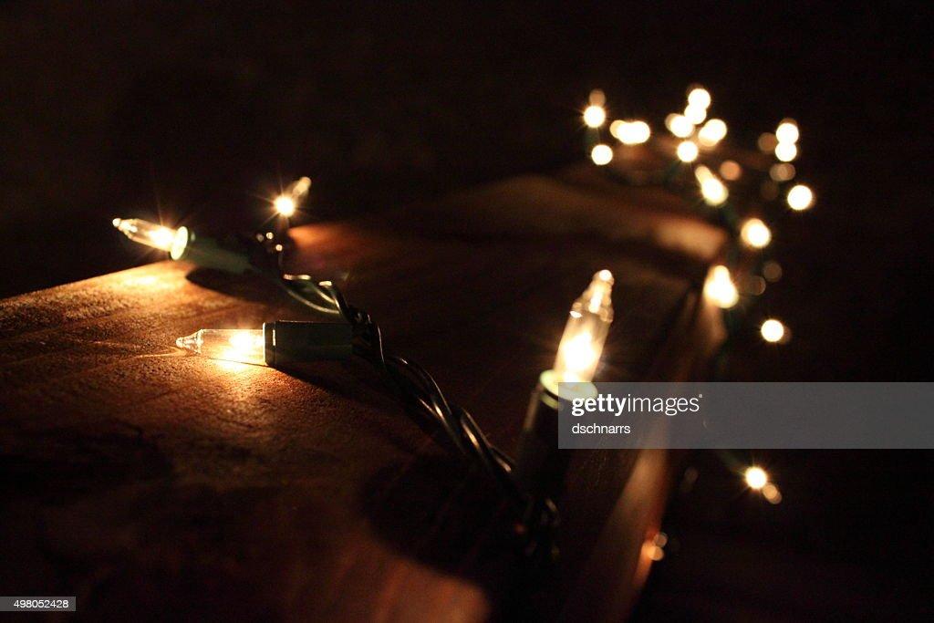Christmas lights spun around a patio railing : Stock Photo