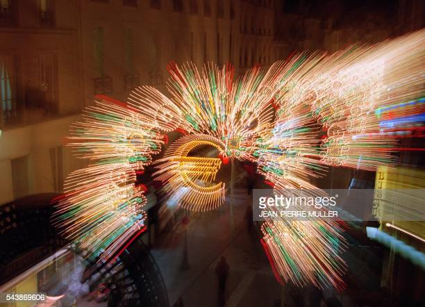 Christmas' lights surround a logo of the single European currency 13 December in Paris where the shopkeepers prepare the switch to the euro scheduled...