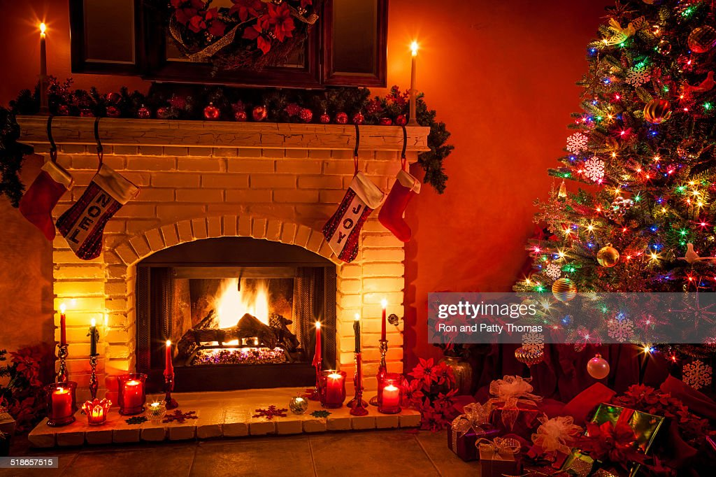 Fireplace Christmas.Christmas Living Room With Fireplace And Presents Under Tree