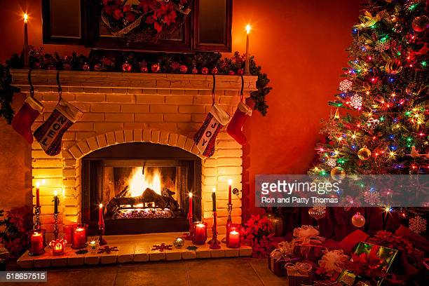 Christmas living room with fireplace and presents under tree (P)