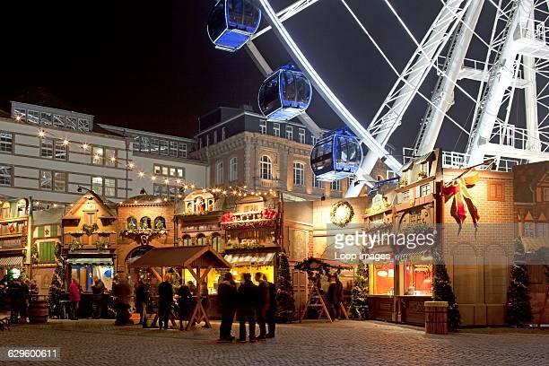 Christmas market and ferris wheel in the Old Town of Dusseldorf Dusseldorf Germany