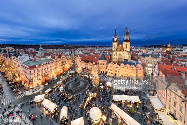 christmas market and the church of our lady of tyn on the old town square, prague, bohemia, czech republic - bohemia czech republic stock pictures, royalty-free photos & images