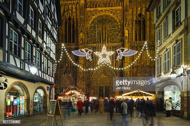 christmas market at strasbourg cathedral - strasbourg stock pictures, royalty-free photos & images