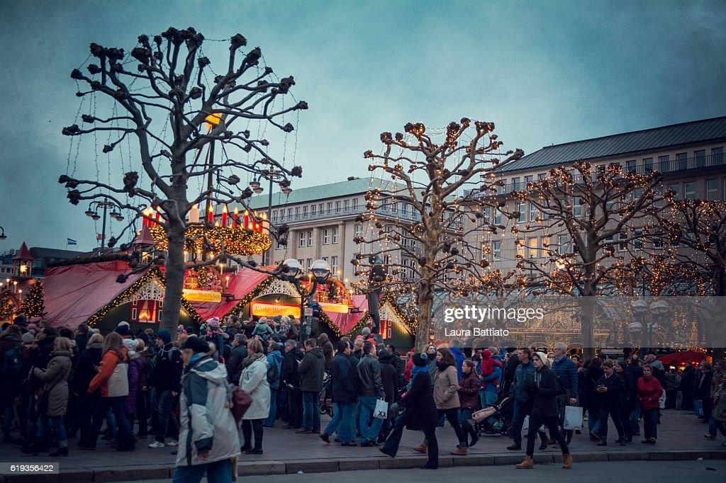 Christmas market fairy ambiance at the Hamburg Rathaus Markt : Stock Photo