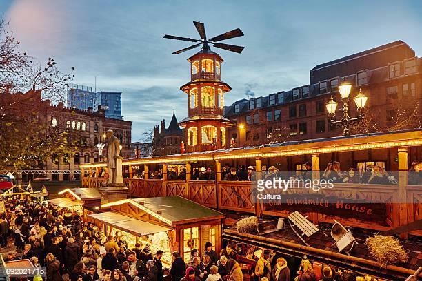 christmas market illuminated at night, albert square, manchester, uk - manchester england stock pictures, royalty-free photos & images