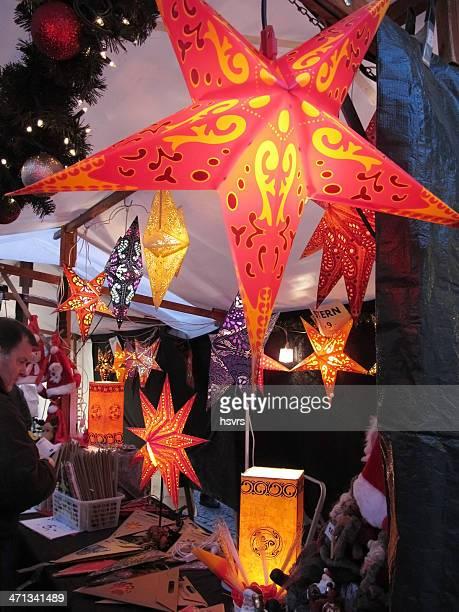 Christmas market in Berlin man wanna buy star lamp (Germany)