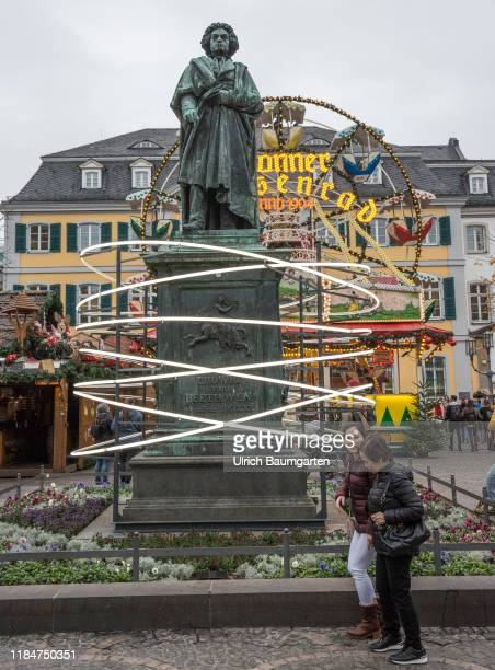 Christmas market in Bonn Thanks to this light installation for the Beethoven anniversary it looks as though Beethoven is hovering above everything on...